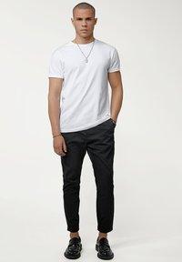 Tigha - Trousers - black - 1