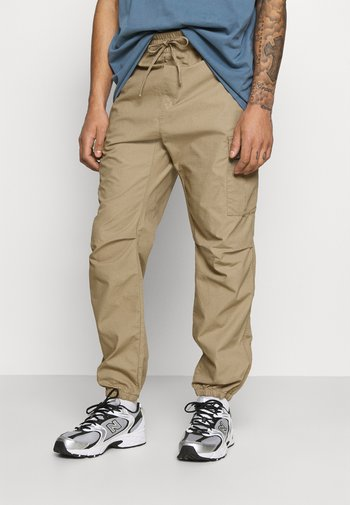 JOGGER COLUMBIA - Cargo trousers - sand