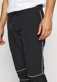 Jack & Jones - JJINEEDO PANTS - Pantalones deportivos - black - 4