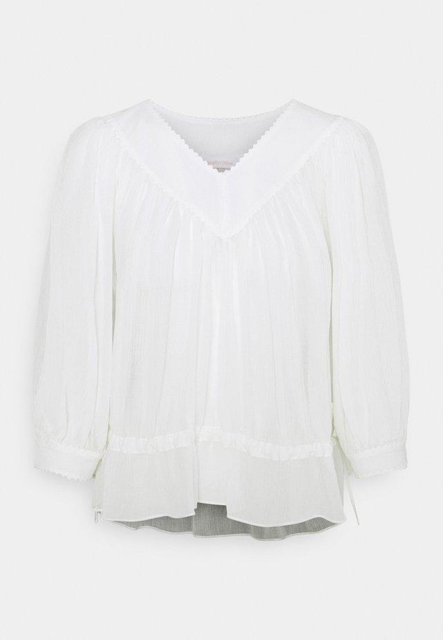 Blusa - crystal white