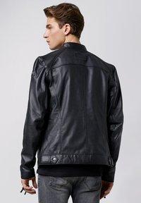 Tigha - Leather jacket - black - 2