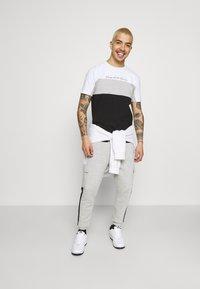 Kings Will Dream - CHAPMAN  - Cargo trousers - grey marl/black/white - 1