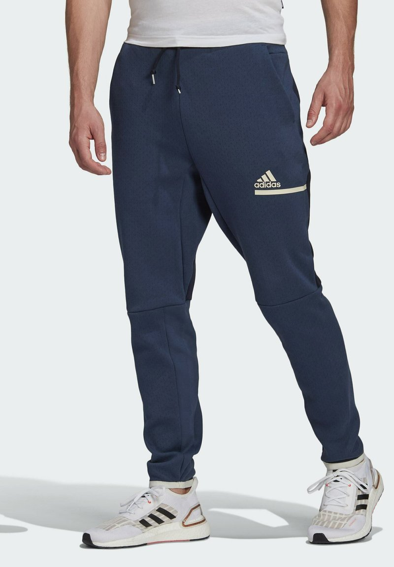 adidas Performance - Z.N.E. SPORTSWEAR PRIMEGREEN PANTS - Pantalon de survêtement - blue