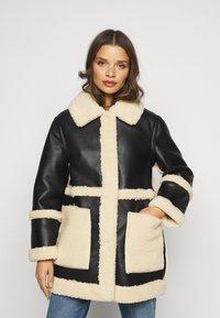 Topshop Petite - BONDED BORG REVERSIBLE SHACKET - Winter coat - black/cream - 0