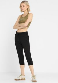 ONLY Play - ONPELINA 3/4 PANTS - Tracksuit bottoms - black - 1