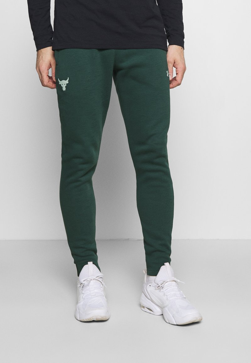 Under Armour - ROCK PANT - Tracksuit bottoms - ivy