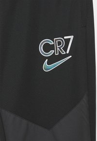 Nike Performance - CR7 DRY PANT - Tracksuit bottoms - black/white/iridescent - 2