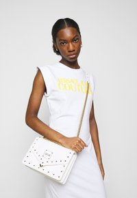 Versace Jeans Couture - ACTIVE DRESS - Jersey dress - optical white - 3
