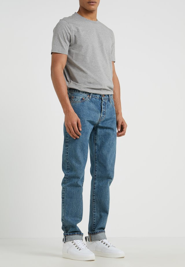 Zúžené džíny - heavy stone wash