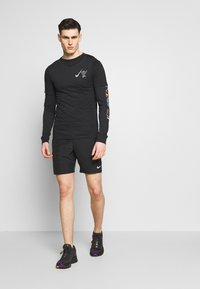 Nike Performance - RUN SHORT - Pantalón corto de deporte - black - 1
