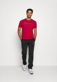 Champion - STRAIGHT PANTS - Teplákové kalhoty - black - 1