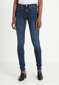 Calvin Klein Jeans - CKJ 011 MID RISE SKINNY  - Jeans Skinny Fit - amsterdam blue mid - 0