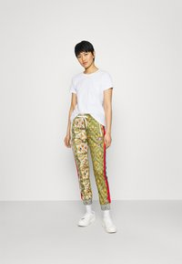 Replay - PANTS - Tracksuit bottoms - red/green/multicolor - 1