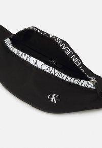 Calvin Klein Jeans - WAISTBAG MIRROR UNISEX - Bum bag - black - 2