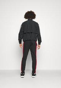 adidas Performance - Träningsbyxor - black/scarlet - 2