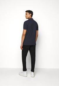 HUGO - DINOSO - Polo shirt - dark blue - 2