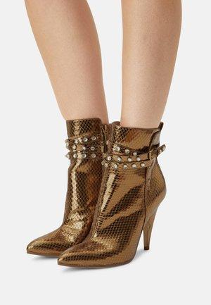 JESSIA - Kotníková obuv na vysokém podpatku - bronzo