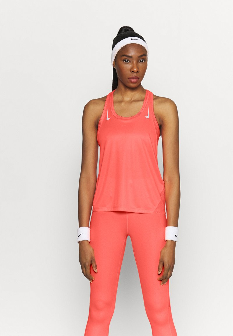 Nike Performance - MILER TANK RACER - Sportshirt - bright mango/reflective silver
