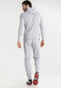 Erima - ESSENTIAL  - Tracksuit bottoms - light grey melange/black - 2