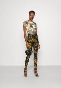 Versace Jeans Couture - PANTS - Legginsy - black/gold - 1