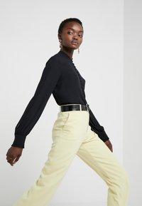 Filippa K - SHEER BUTTON BLOUSE - Button-down blouse - black - 4