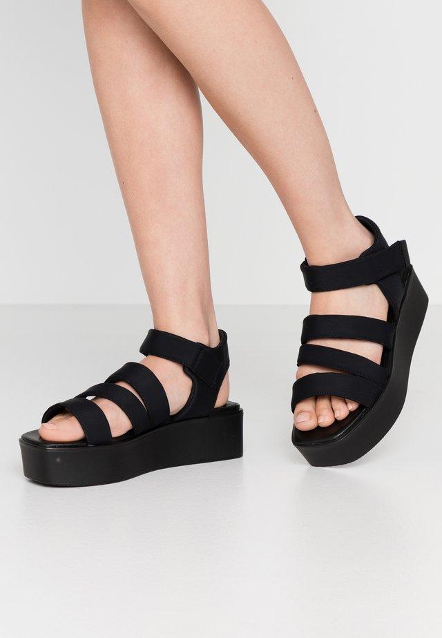 BONNIE - Korkeakorkoiset sandaalit - black