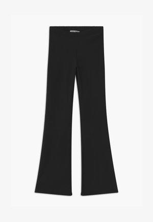 ZUMA - Trousers - black