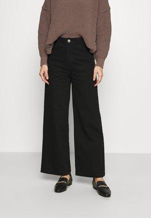 CALM - Flared jeans - black