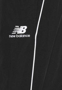 New Balance - ATHLETICS WIND PANT - Tracksuit bottoms - black - 5