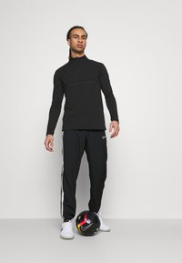 Nike Performance - Sportshirt - black - 1