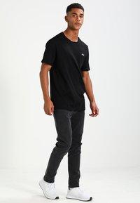 Fila - UNWIND TEE - Camiseta básica - black - 1