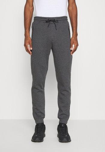 Pantaloni sportivi - mottled dark grey