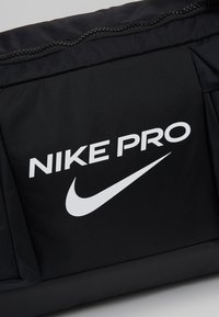 Nike Performance - POWER M DUFF PRO - Sports bag - black/white - 7