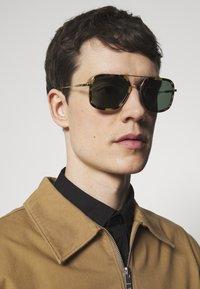 Prada - Sunglasses - brown/pale gold-coloured - 1