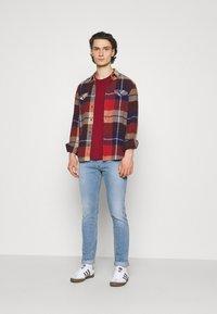 Diesel - D-LUSTER - Slim fit jeans - light blue - 1