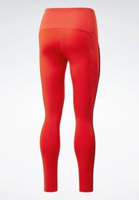 Reebok - STUDIO LUX PERFORM LEGGINGS - Legging - red - 8