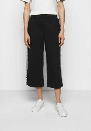 LOGO TAPE PANTS - Trousers - black