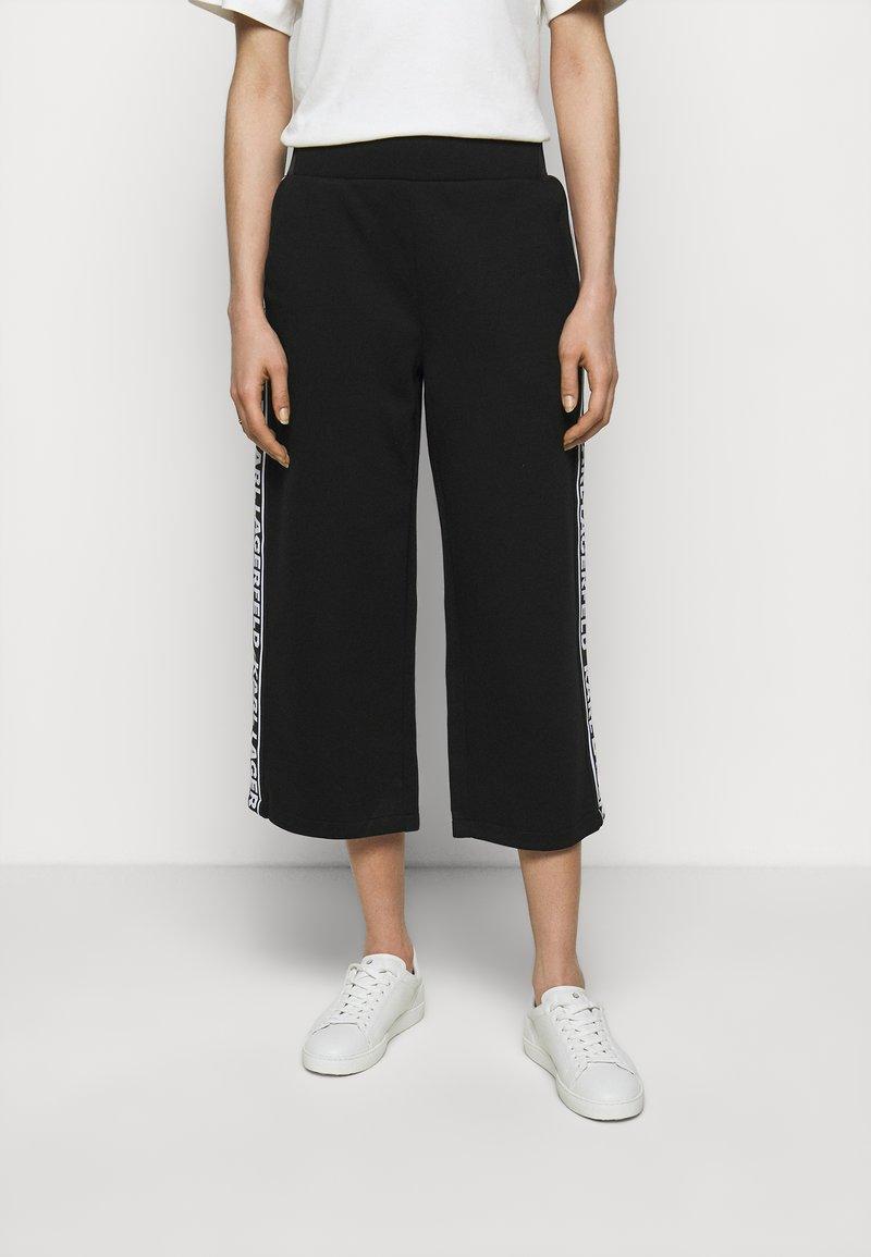 KARL LAGERFELD - LOGO TAPE PANTS - Trousers - black