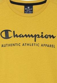 Champion - AMERICAN CLASSICS LONG SLEEVE CREWNECK  - Top sdlouhým rukávem - mustard yellow - 3