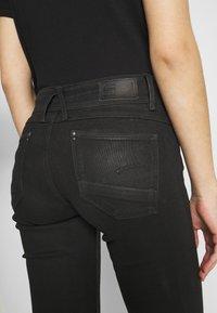G-Star - LYNN MID SKINNY WMN - Jeans Skinny Fit - black radiant cobler - 6