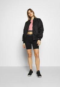Calvin Klein Jeans - MILANO CYCLING - Shorts - black - 1