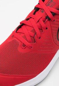 Nike Performance - STAR RUNNER 2 UNISEX - Neutral running shoes - university red/black/volt - 5