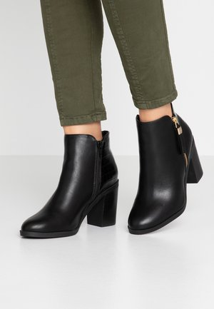 ALBANY - High heeled ankle boots - black croc