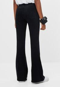 Bershka - Bootcut jeans - black - 2