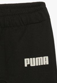 Puma - PUMA X ZALANDO BABY - Verryttelypuku - black - 3
