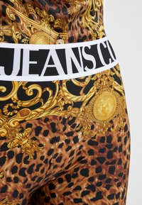 Versace Jeans Couture - Leggings - Trousers - gold - 5