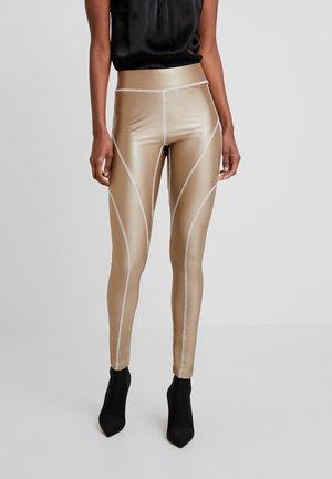 YOGA OVERLOCK - Leggings - Trousers - gold