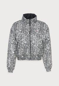 Calvin Klein Jeans - REVERSIBLE PADDED JACKET - Light jacket - black - 3