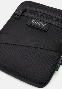 Guess - MASSA CONVERTIBLE CROSSBODY - Across body bag - black - 4