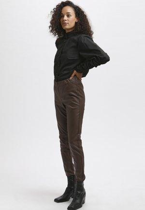 ADA COATED - Leggings - Trousers - brown